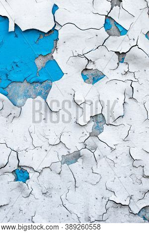Peeling Paint On Old Concrete Wall. Cracked Plaster, Flaky Stucco. Blue And White Painted Abstract B