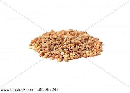 Pile Of Buckwheat Groats Isolated On White Background Close-up
