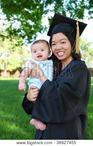 A pretty asian woman with baby boy at graduation ceremony