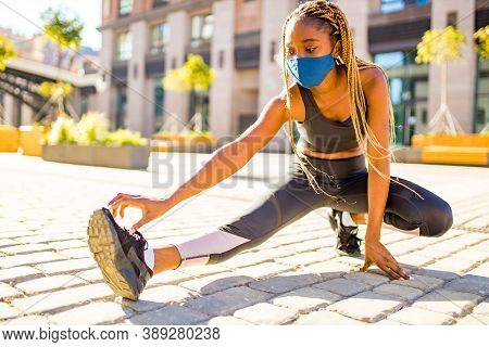 African American Woman With Long Yellow Dreadlocks Pigtails Working Out Outdoors With Mask In Down T