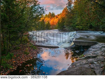 Scenic Bond falls in Michigan upper peninsula with sun light reflections