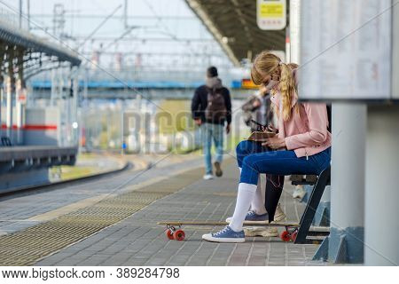Moscow. Russia. October 4, 2020. A Blonde-haired Teenage Girl In A Protective Mask Sits On A Train S
