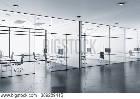 Modern Coworking Office Hall With Panoramic City View, Computers On Table And Glass Walls. Workplace