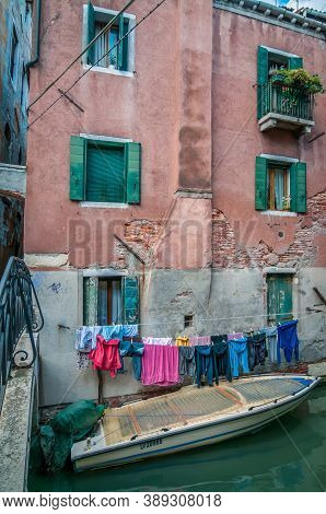 Venice, Italy - May 23, 2013: Typical Window And Boat Near A House In Venice, Italy