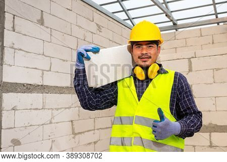 Worker Reassure Holds Autoclaved Aerated Bricks In Construction Site, Concept Proposes To Use Autocl
