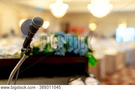 Microphone On Stand At Podium Stage For Public Speaking Or Speech In Conference Hall. Mic For Speake