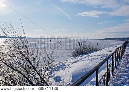 People Of All Ages Walk On The Ice And Fish In Winter, On A Sunny Day Off, On A Frozen Lake. Winter