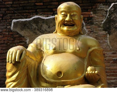 Ayutthaya, Thailand, January 24, 2013: Smiling Buddha In One Of The Temples Of Ayutthaya, Ancient Ca