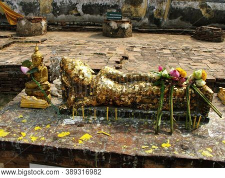 Ayutthaya, Thailand, January 24, 2013: Reclining Buddha Covered In Gold Leaf In Ayutthaya, Former Ca