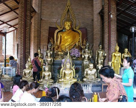 Ayutthaya, Thailand, January 24, 2013: Faithful Praying In A Temple In Ayutthaya, Former Capital Of