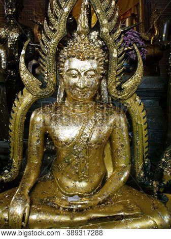 Ayutthaya, Thailand, January 24, 2013: Buddha Sculpture Covered With Gold Leaf In A Temple In Ayutth