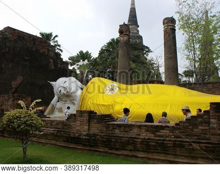 Ayutthaya, Thailand, January 24, 2013: Reclining Buddha Covered With A Golden Cloth In Ayutthaya, Fo