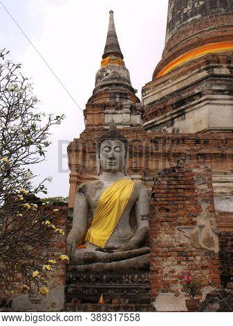 Ayutthaya, Thailand, January 24, 2013: Vertical View Of Stone Buddha Under A Stupa In Ayutthaya, For