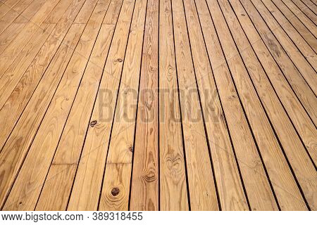 Outdoor Wooden Floor Made Of Uncolored Boards, Background Photo Texture With Perspective Effect