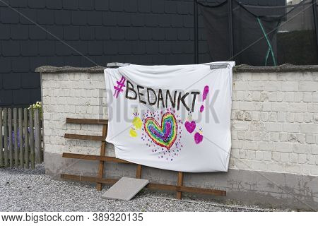 Sint Gillis Waas, Belgium, April 14, 2020, Banner With The Text Thank You Painted On It For The Peop