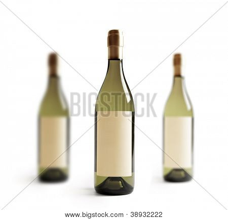 Three white wine bottle, with real paper blank label. Label is at eye level so inserted elemets do not need to be curved (wrapped around) so much. Focus on center label. Isolated on white.
