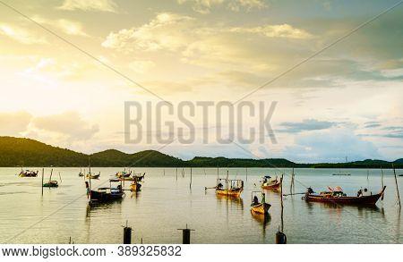Thai long tail fishing boats at fishing village on Ko Yao Yai island in the Andaman Sea in Thailand
