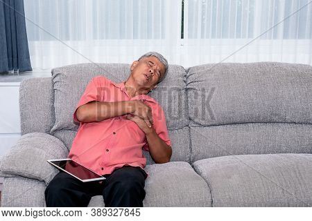 Portrait Images Of Elderly Man Sitting On Sofa, Are Suffering From Angina Due To Heart Disease, To R