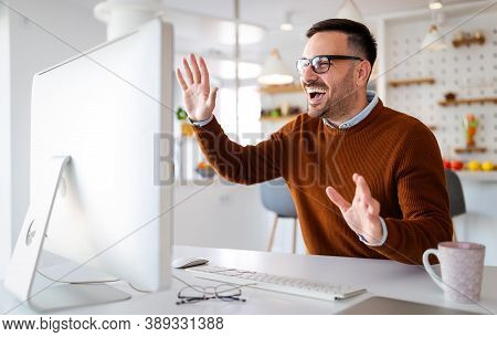 Man Having Video Conferencing Call Via Computer. Working Remotely Managing Team And Work From Home