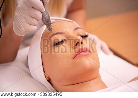 Middle Aged Woman Having A Electronic Acupuncture Pen Treatment