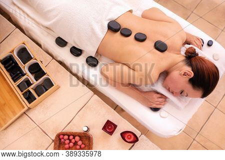 Woman Lying On A Massage Table In Spa