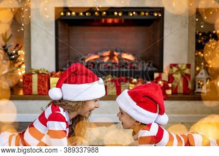 Happy Children Near Fireplace At Christmas