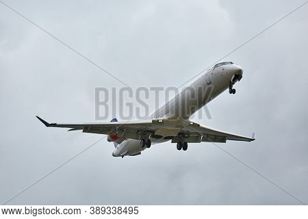 Plane approaching landing in cloudy overcast weather