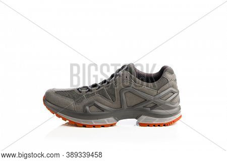 trekking sneaker with red sole, isolated on white