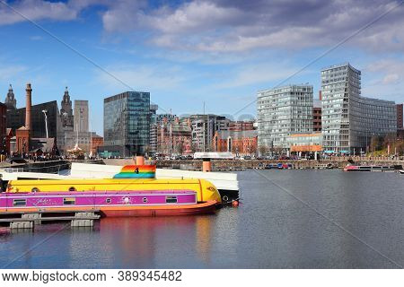 Liverpool, Uk - April 20, 2013: Modern And Old City Blends In The Docks In Liverpool, Uk. Famous Doc