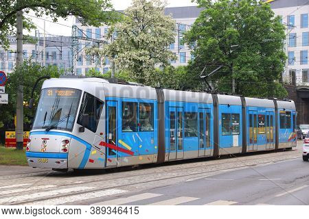 Wroclaw, Poland - May 11, 2018: People Ride Public Transportation City Electric Tram (light Rail) In