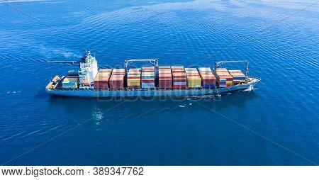 Cargo Ship Full Loaded With Containers, Blue Sea Background