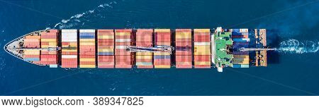 Cargo Ship Full Loaded With Containers, Blue Sea Background, Top View