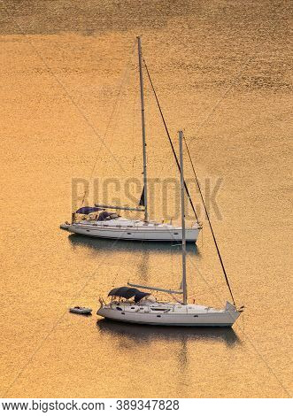 Sailing Boats At Sunset, Sunrise. Copy Space, Vertical Photo.