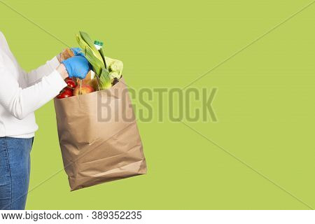 Food Delivery, Online Shopping Or Donation Concept. Grocery Store Shopping. Girl Or Woman Holds A Pa