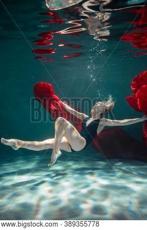 Young Slender Girl Underwater. Water Magic. Underwater Photography. Art