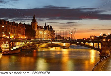 View On Seine River And Conciergerie In Paris . Colourful Travel Background. Romantic Cityscape