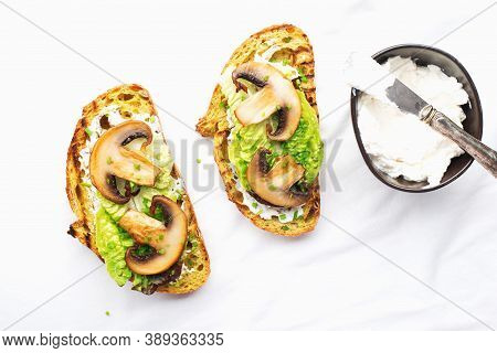 Crispy Bread Slices With Cottage Cheese, Green Lettuce Leaves, Fried Champignon Wedges. The Appetize