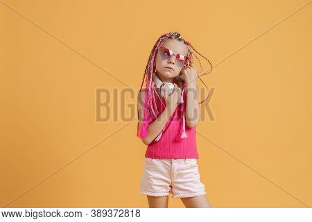Crazy Expressive Trendy Dj Girl In Bright Clothes, Headphones And Bright Dreadlocks. Disco, Party. B