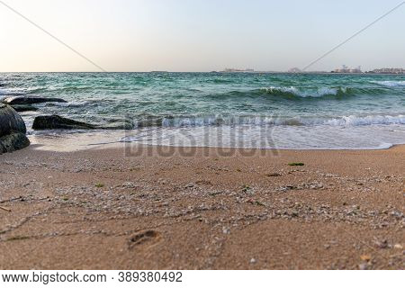 Waves Crashing Against The Shore Of Persian Gulf, Seascape Seen From Dubai Bluewaters Island, Dubai