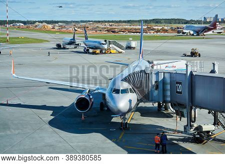 Moscow, Russia - September 16, 2020: Boarding Passengers On A Plane Using A Jet Bridge At Sheremetye