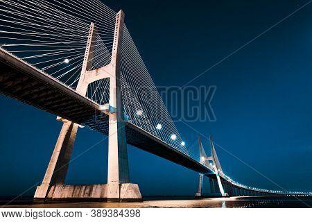 Vasco Da Gama Bridge In Lisbon By Night, Portugal