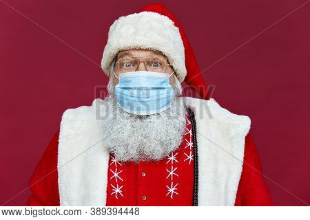 Close Up Portrait Of Funny Old Bearded Surprised Santa Claus Wearing Costume, Glasses, Face Mask Loo