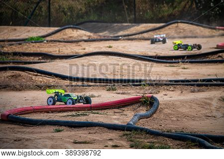 Rc Buggy Going Through A Turn On An Outdoor Track During A Race