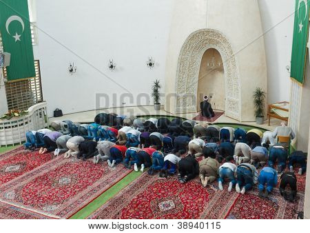 ZAGREB, CROATIA - SEPT 25, 2012. Zagreb Imam leading afternoon prayer in mosque on September 25, 2012 in Zagreb, Croatia. Muslims constitute about 1.3% of the population of Croatia.