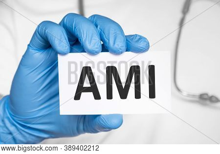 Doctor Holding A Card With Text Ami Acute Myocardial Infarction, Medical Concept