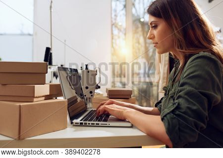 Seamstress Works To New Clothes Ordered By Internet Client