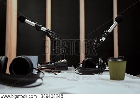 Working Place Of Radio Host. Close Up Of Microphones, Headphones And Sound Mixing Desk On The Table