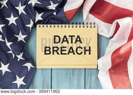 Text Data Breach On Notepad With American Flag Background