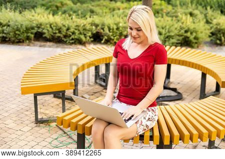 Euphoric Woman Searching Job With A Laptop In An Urban Park In Summer