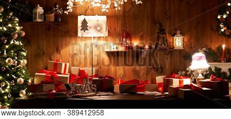 Decorated Xmas Table With Merry Christmas Gifts In Cozy Santa Home Interior, Banner. Happy New Year
